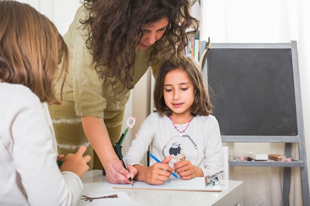 Mother taught daughters how to draw Free Photo