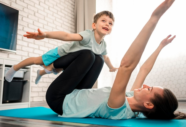 Mother training together with happy son Free Photo