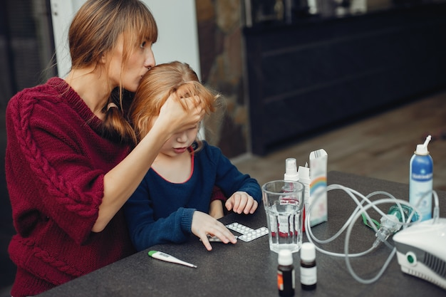 Mother treats her daughter at home Free Photo