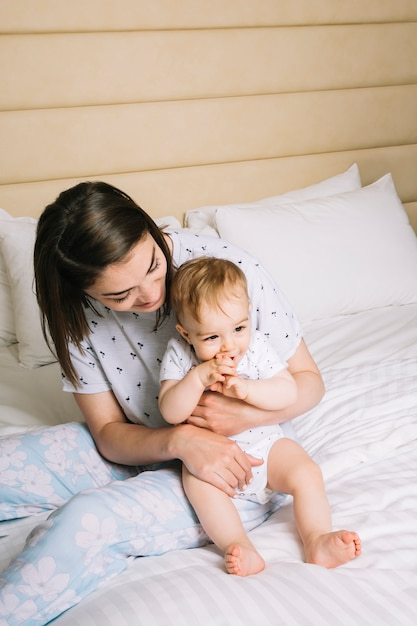 Mother with baby in bed Free Photo