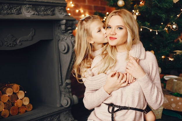 Mother with cute daughter at home Free Photo