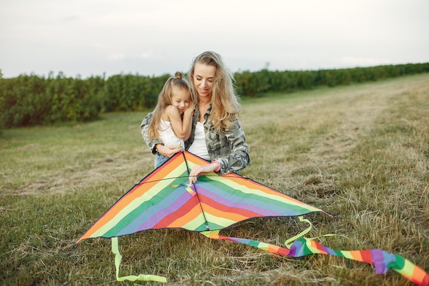 Mother with cute little daughter in a summer field Free Photo