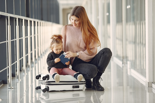 Mother with daughter at the airport Free Photo