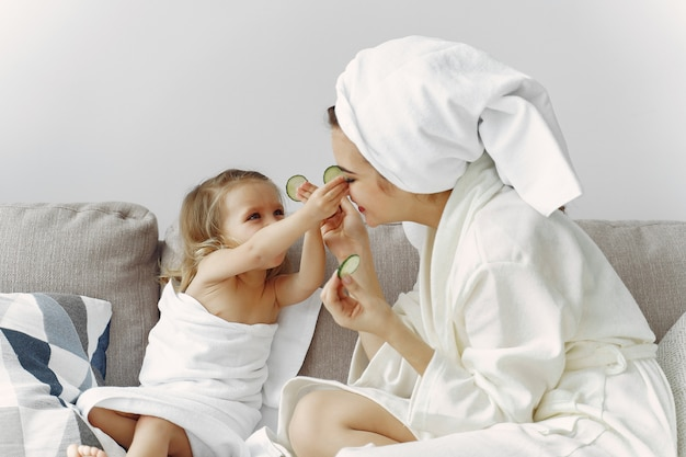 Mother with daughter in bathrobe and towels Free Photo