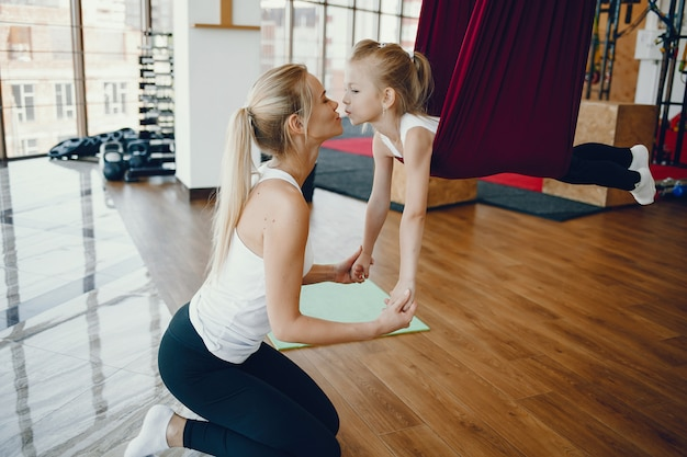 Mother with daughter in a gym Free Photo