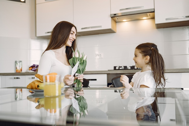 Mother with daughter at home Free Photo