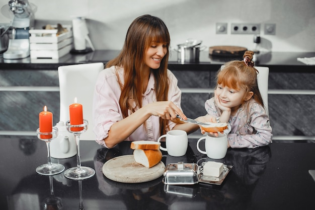 Mother with daughter in a kitchen Free Photo