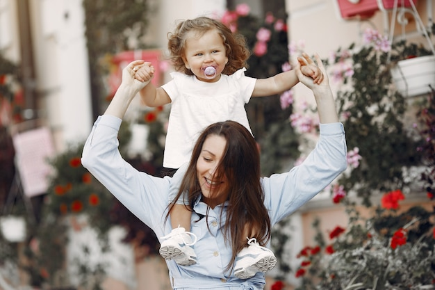 Mother with daughter playing in a summer city Free Photo