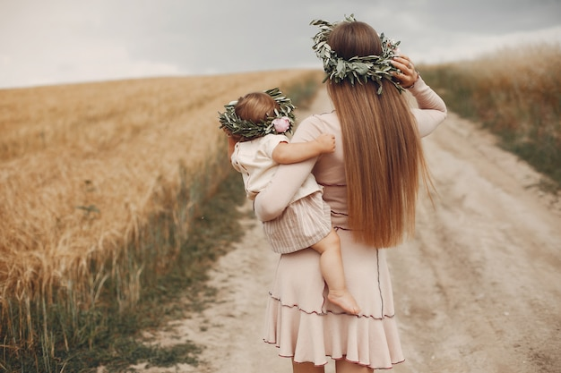 Mother with daughter playing in a summer field Free Photo