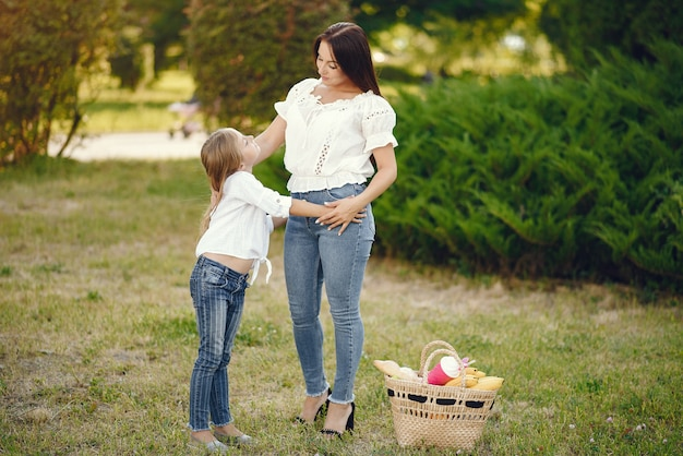 Mother with daughter playing in a summer park Free Photo