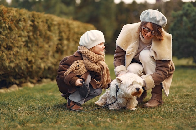 Mother with daughter walks with a dog Free Photo