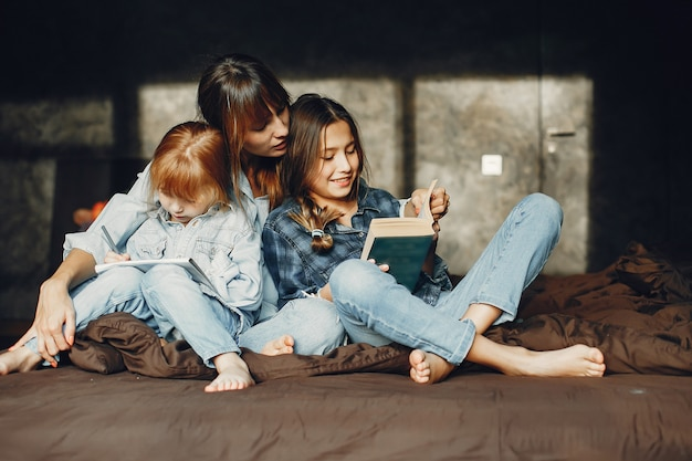 Mother with daughters at home Free Photo