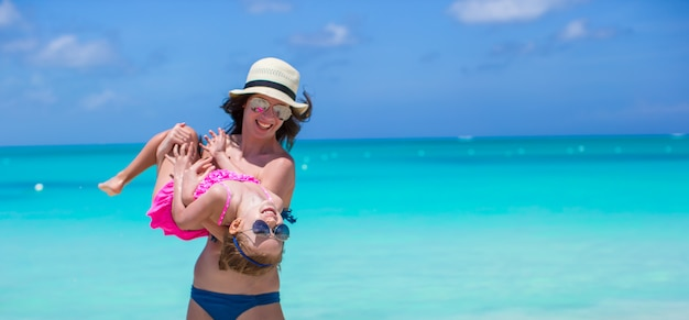 Mother with her cute daughter have fun on summer vacation Premium Photo