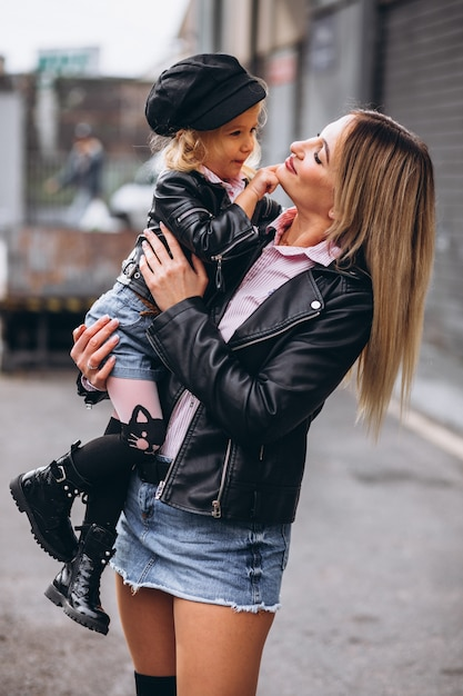 Mother with her little baby daughter outside the street Free Photo