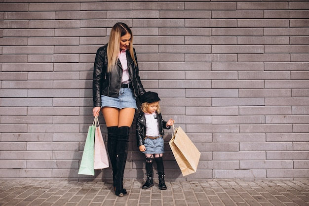 Mother with her little cute daughter with shopping bags Free Photo