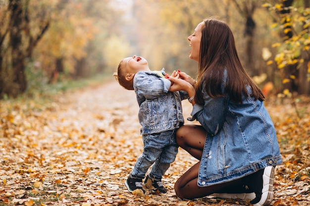 Mother with her little son in autumn park Free Photo