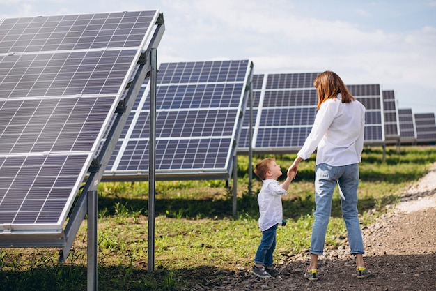 Mother with her little son by solar panels Free Photo