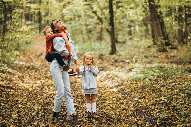 Mother with her little son and daughter in an autumn park Free Photo