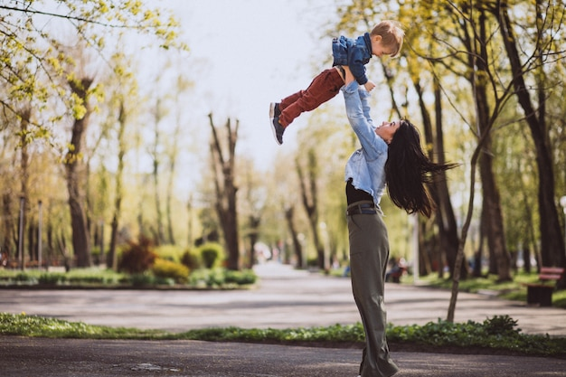 Mother with her little son having fun in park Free Photo