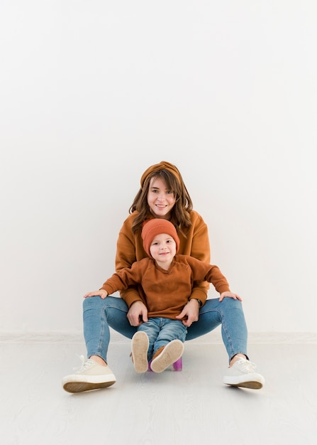 Mother with little boy on skateboard Free Photo