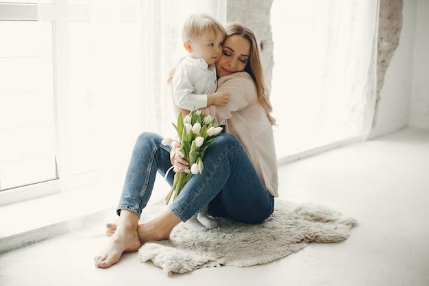 Mother with little child at hme Free Photo
