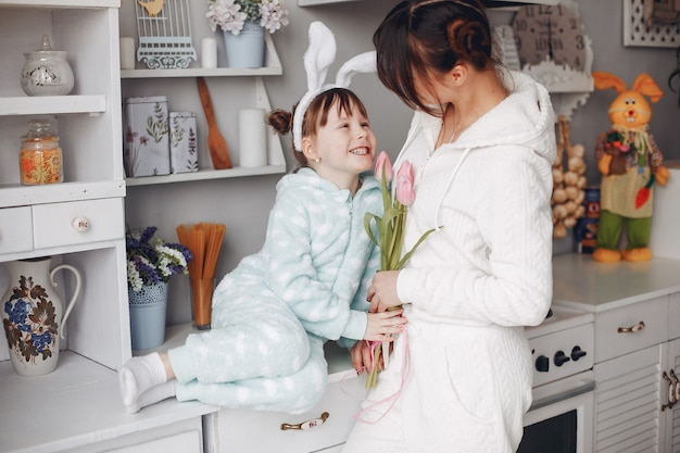 Mother with little child at home Free Photo