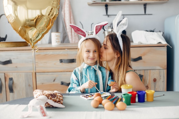 Mother with little daughter in a kitchen Free Photo