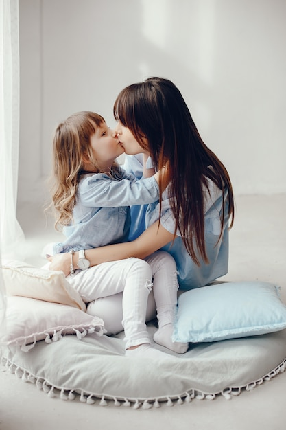 Mother with little daughter in a room Free Photo
