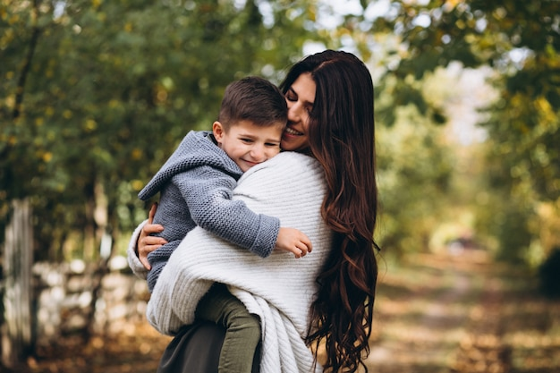 Mother with little son in an autumn park Free Photo