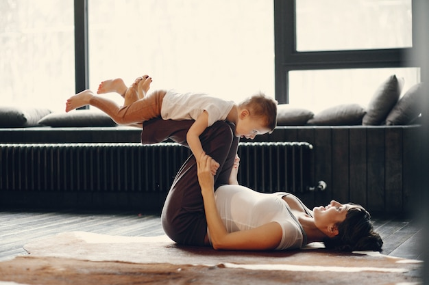 Mother with little son doing yoga at home Free Photo