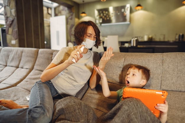 Mother with littler son sitting at home on quarantine Free Photo