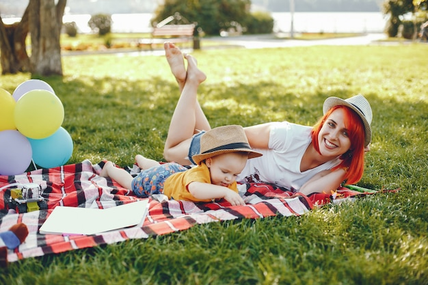 Mother with son playing in a summer park Free Photo