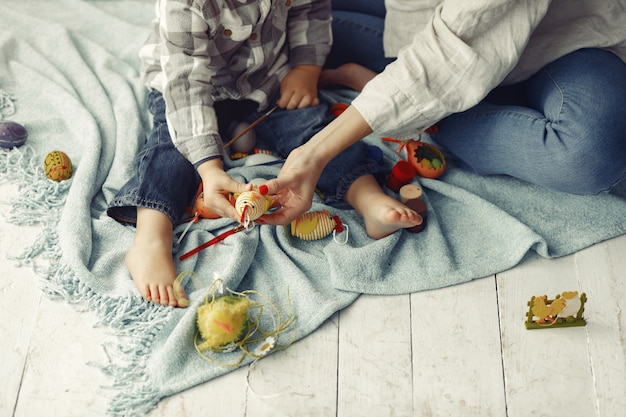 Mother with son preparing to easter at home Free Photo