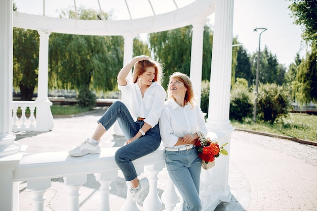 Mother with young daughter in a summer park Free Photo