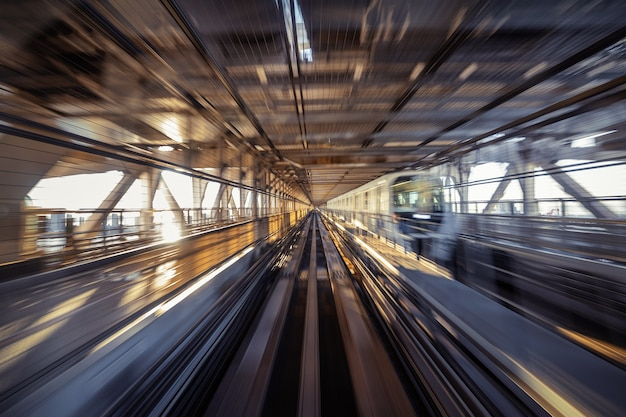 Motion blur of automatic train moving inside tunnel in tokyo, japan. Free Photo