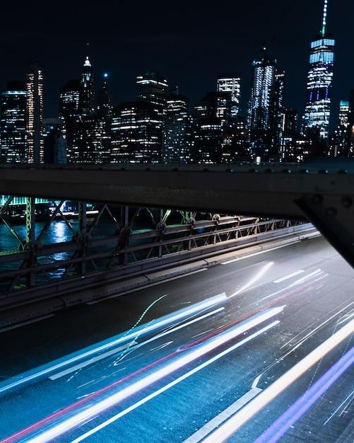 Motion blur bridge with vehicles at night Free Photo