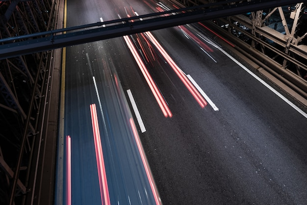 Motion blur traffic on bridge close-up Free Photo