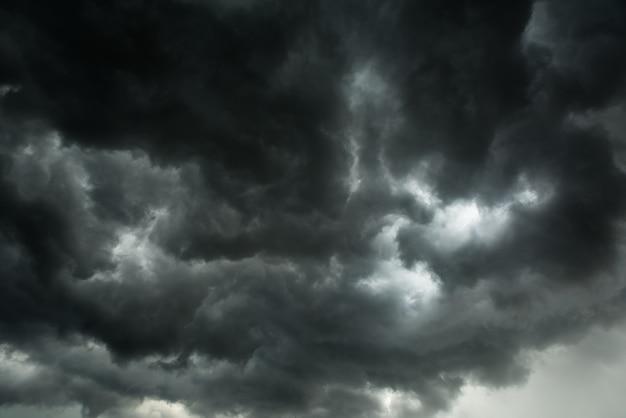 Motion of dark sky and black clouds, dramatic cumulonimbus cloud with rainy Premium Photo