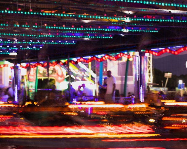 Motion dodgems attraction with colorful lamps Free Photo
