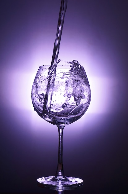 Motion Of Pouring Splash Water In Transparent Wine Glass