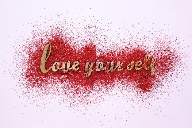 Motivational writing on red glitter Free Photo