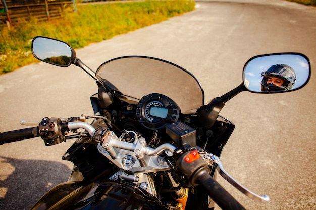 Motorbike grips with rearview mirrors view of the biker Free Photo