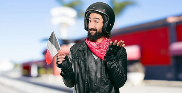 Motorbike rider with a france flag Premium Photo
