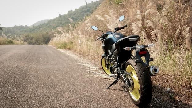 Motorbike with meadow vintage style Premium Photo