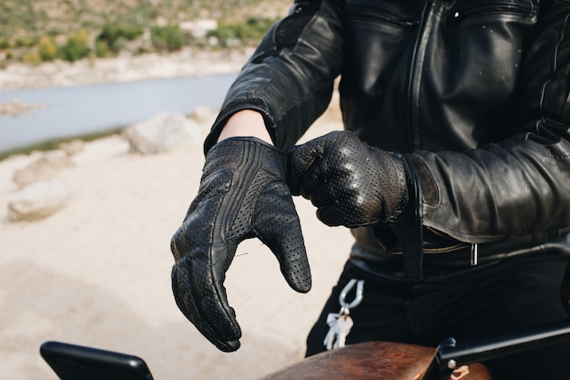 Motorcycle driver wears leather gloves Free Photo