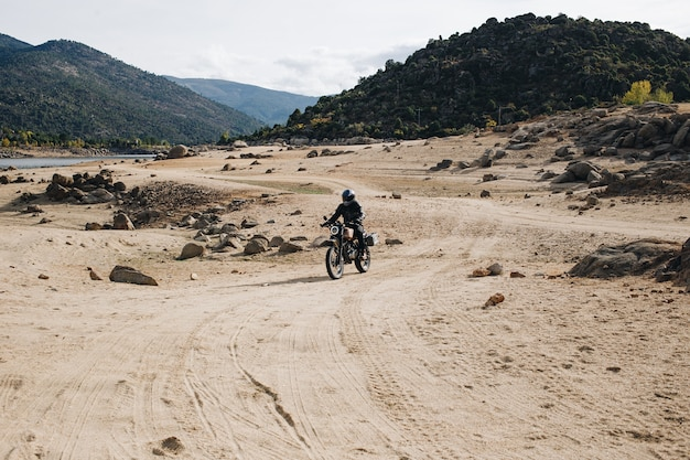 Motorcycle rider on offroad gravel track Free Photo