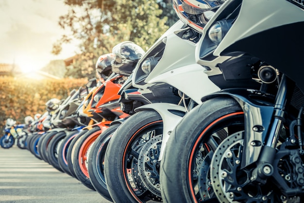 Motorcycles group parking on city street in summer Premium Photo