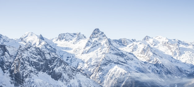 Mountain glacier panoramic view with blue sky and snow Premium Photo