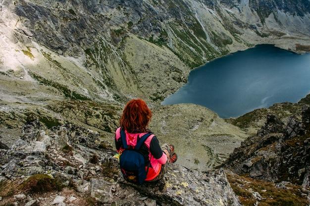 Mountain lake picturesque scenery. traveling woman Premium Photo