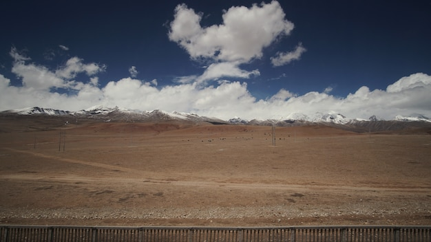Mountain and land with some of clouds and sky with high contrast Premium Photo